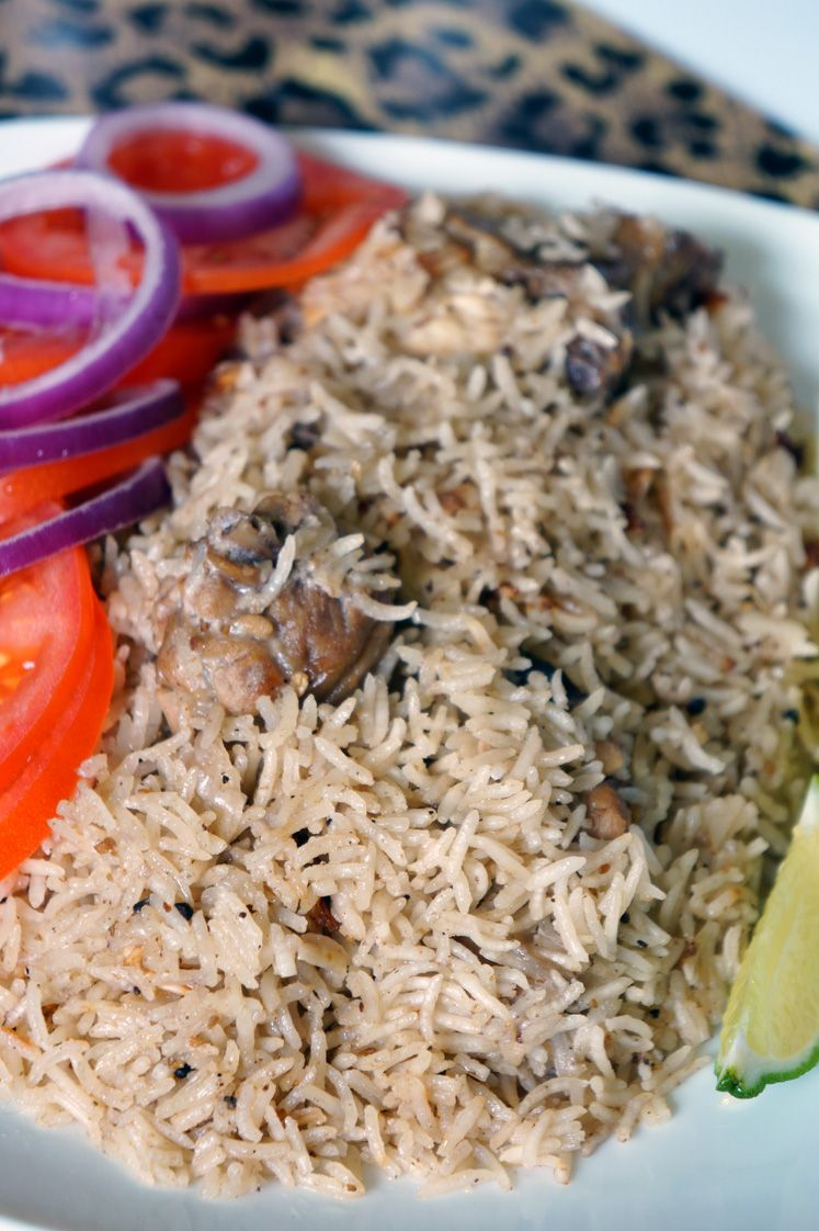Deliciously spiced east African rice pilaf locally called Pilau. This chicken Pilau is an elevated chicken and rice recipe that is very easy to make.