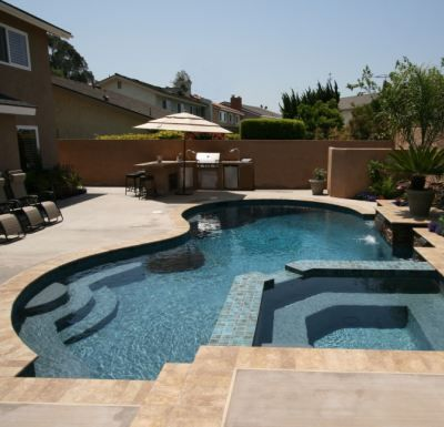 Spectacular pool spa design mixes curves and straight for Residential swimming pool