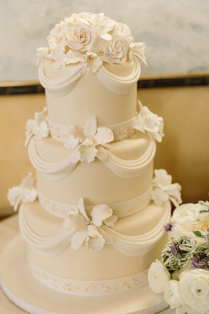 3-tiered fondant white wedding cake + sugar flowers. Photo: Matt ...