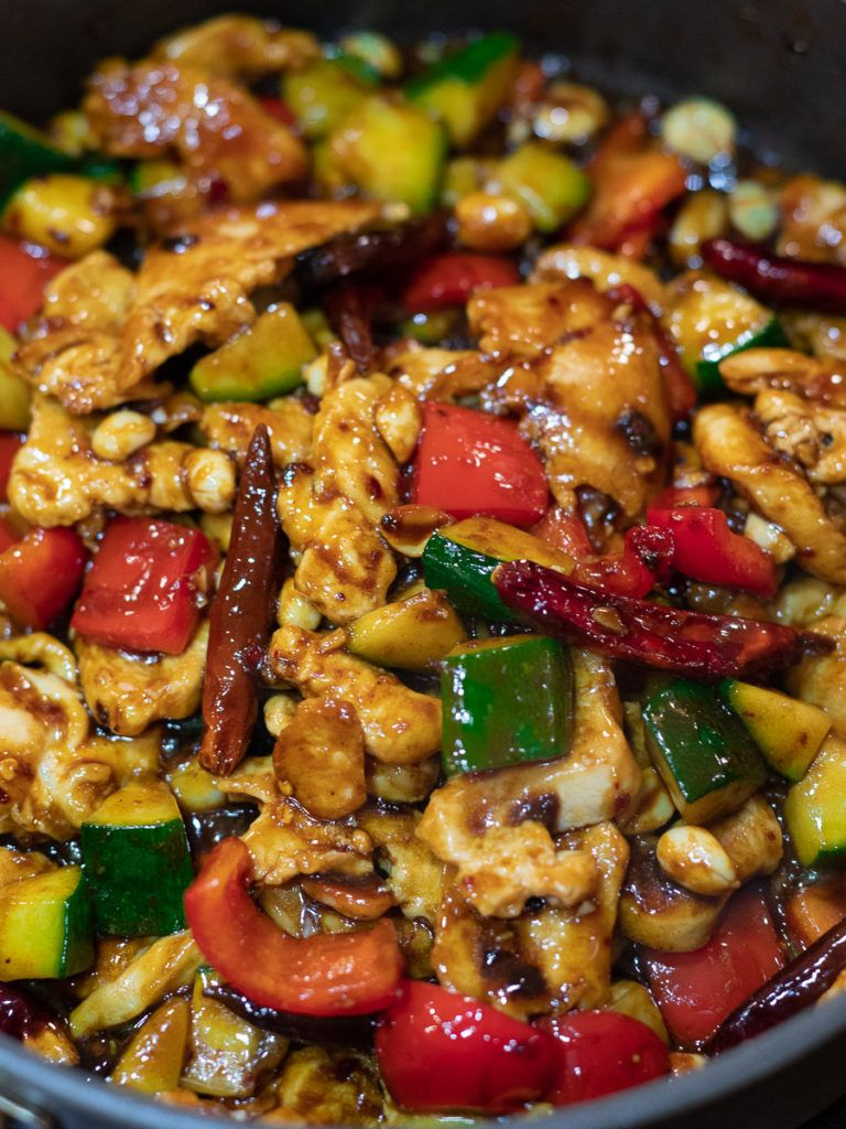 This Panda Express Kung Pao Chicken copycat has tender chicken, zucchini, peppers, peanuts & chilis stir fried in a spicy, sweet & savory kung pao sauce! #kungpao #kungpaochicken #pandaexpress #pandaexpresskungpao | drivemehungry.com