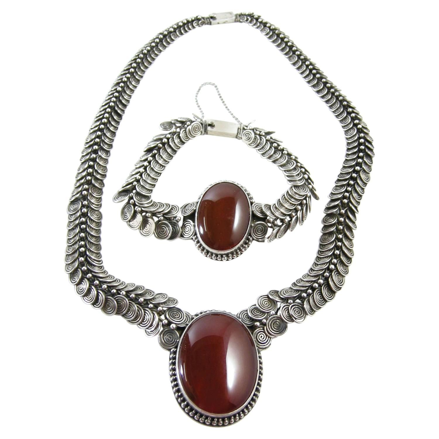 Vintage Sterling Silver Amber Necklace And Bracelet Set | From a unique collection of vintage drop necklaces at https://www.1stdibs.com/jewelry/necklaces/drop-necklaces/