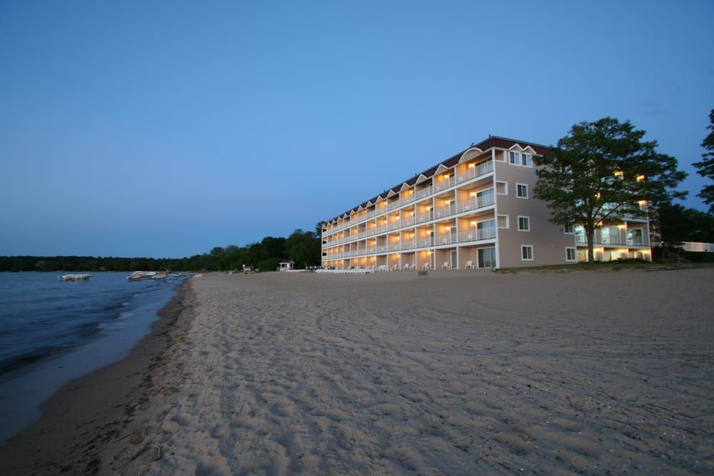 10 Stunning Beach Resorts In Michigan That Are Almost Too Good To Be True Lake Michigan Beaches Beach Resorts Michigan Beaches