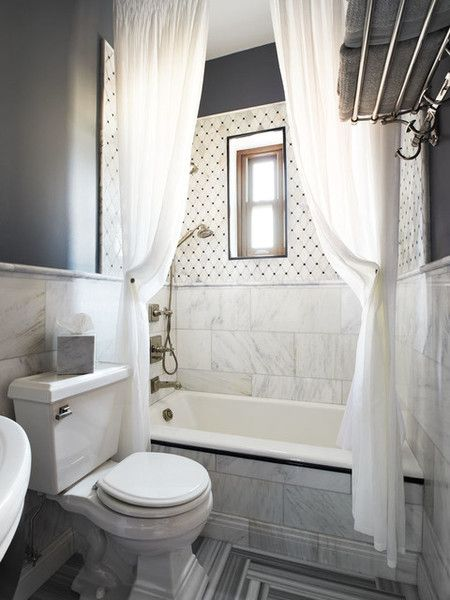 Contemporary White Gray Bathroom With Two Extra Long Shower Curtains Hung Close To The Ceiling Making Look HUGE