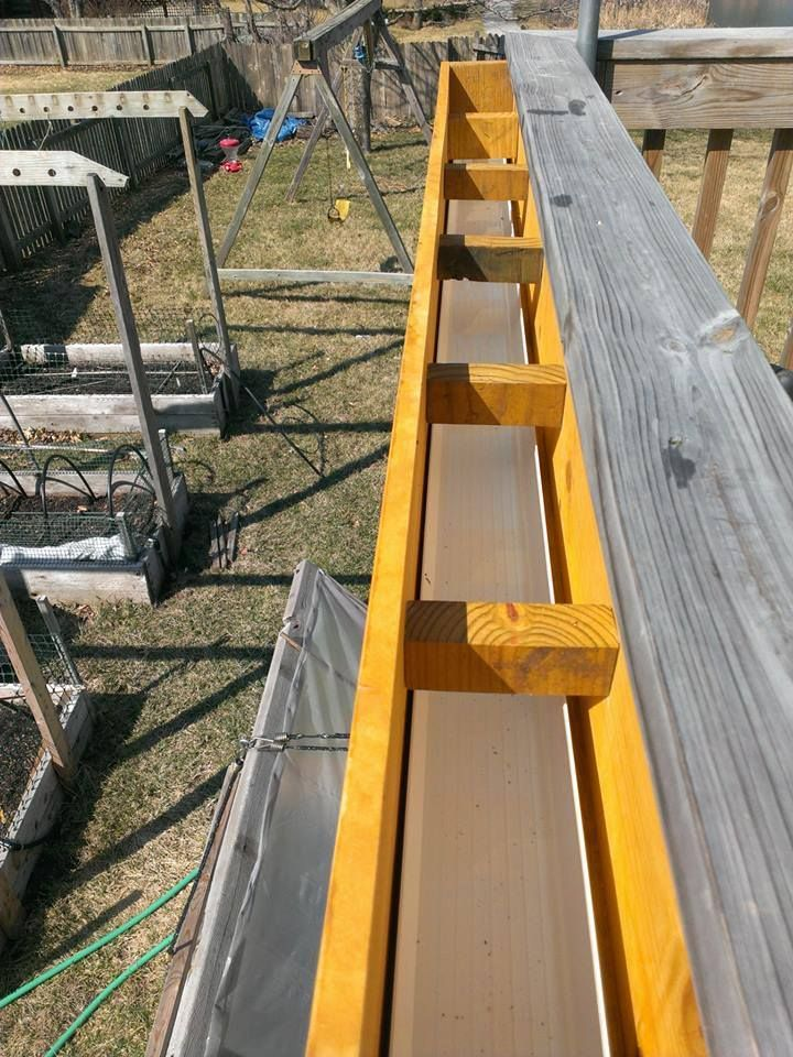Balcony gutter system used to water plants.