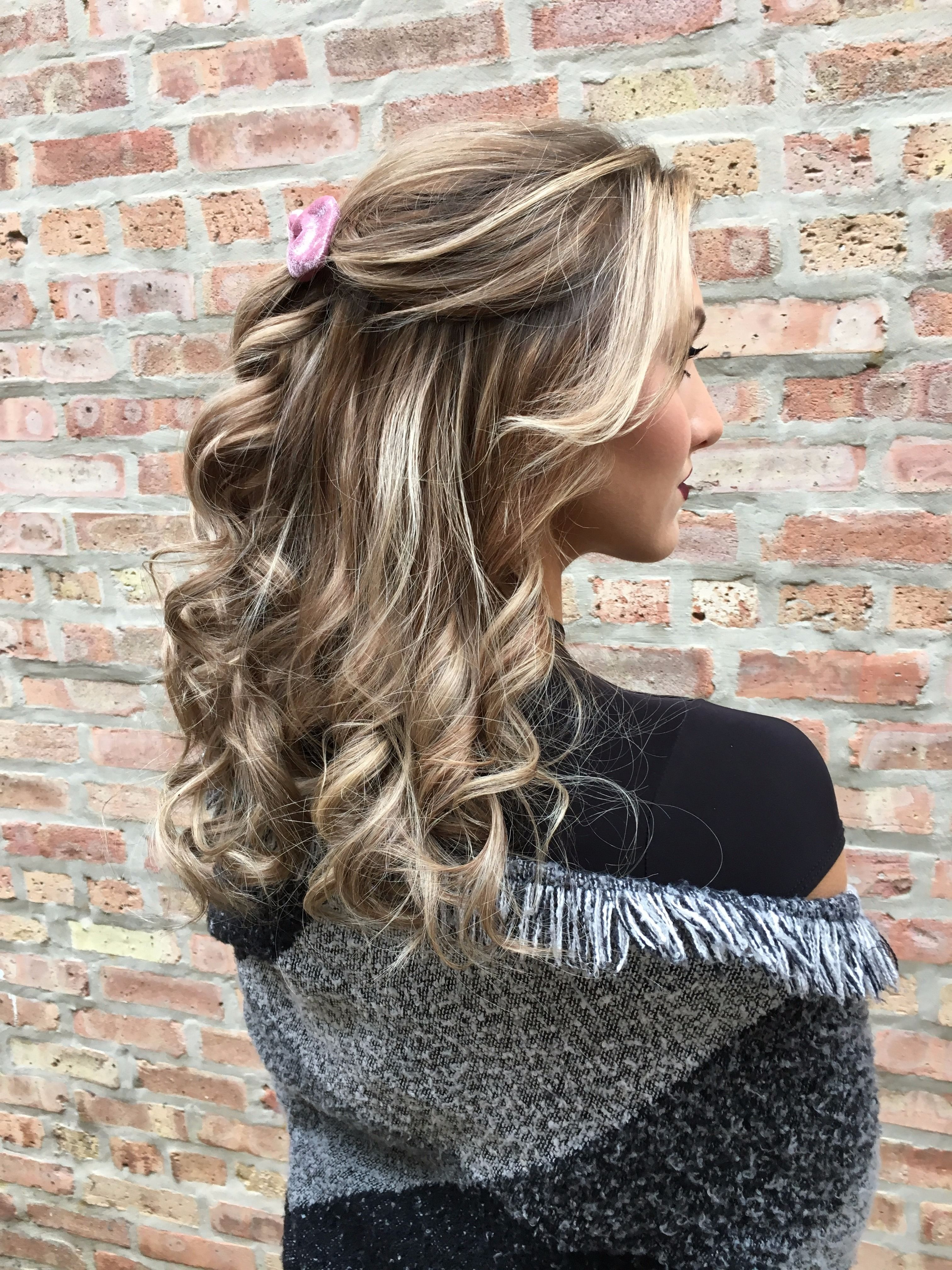 A beautiful cozy half up half down curly hairstyle hair makeup