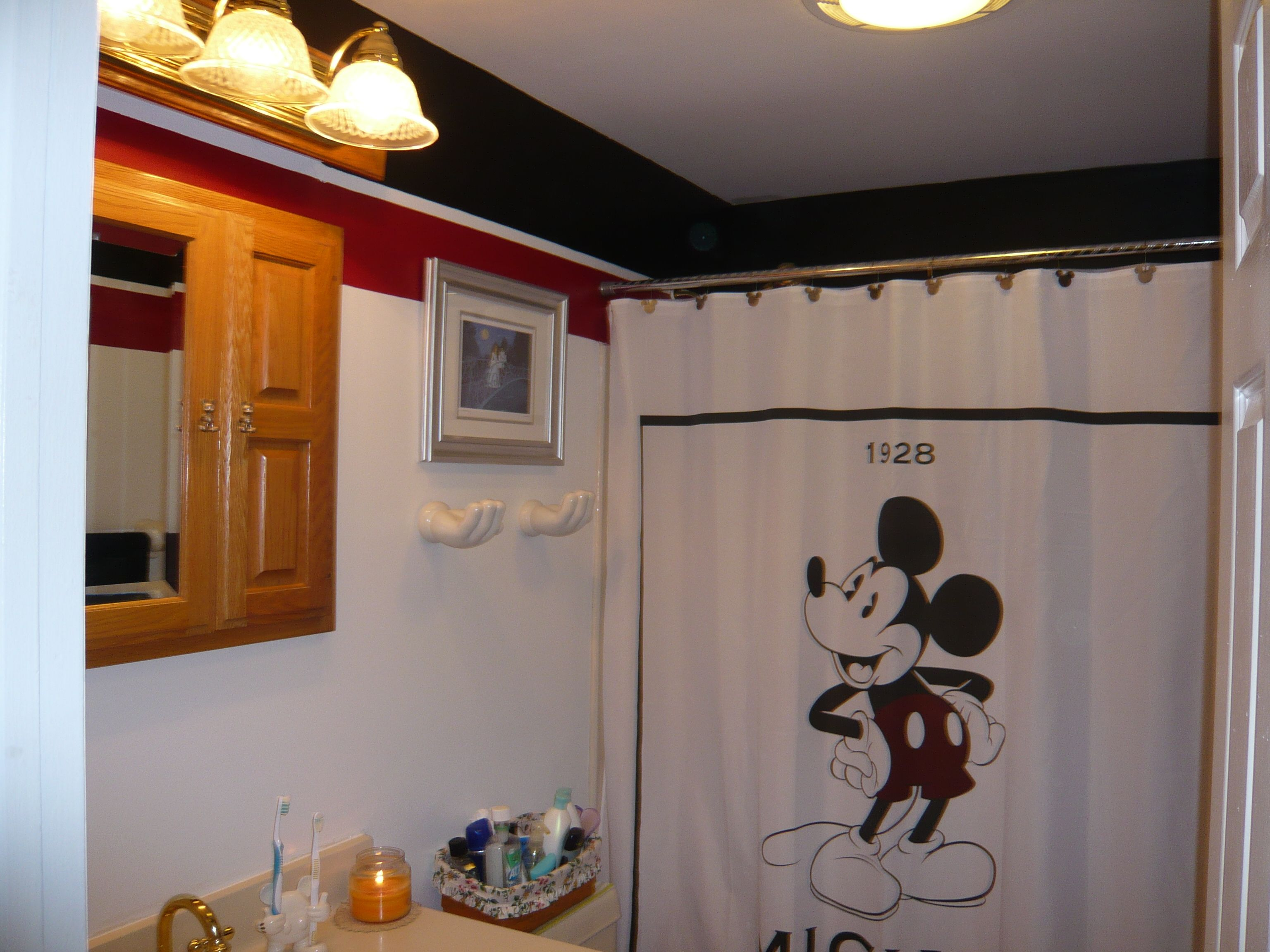 Mickey Mouse Bathroom - Horizontal stripes are a great way to make a space visually appear larger.