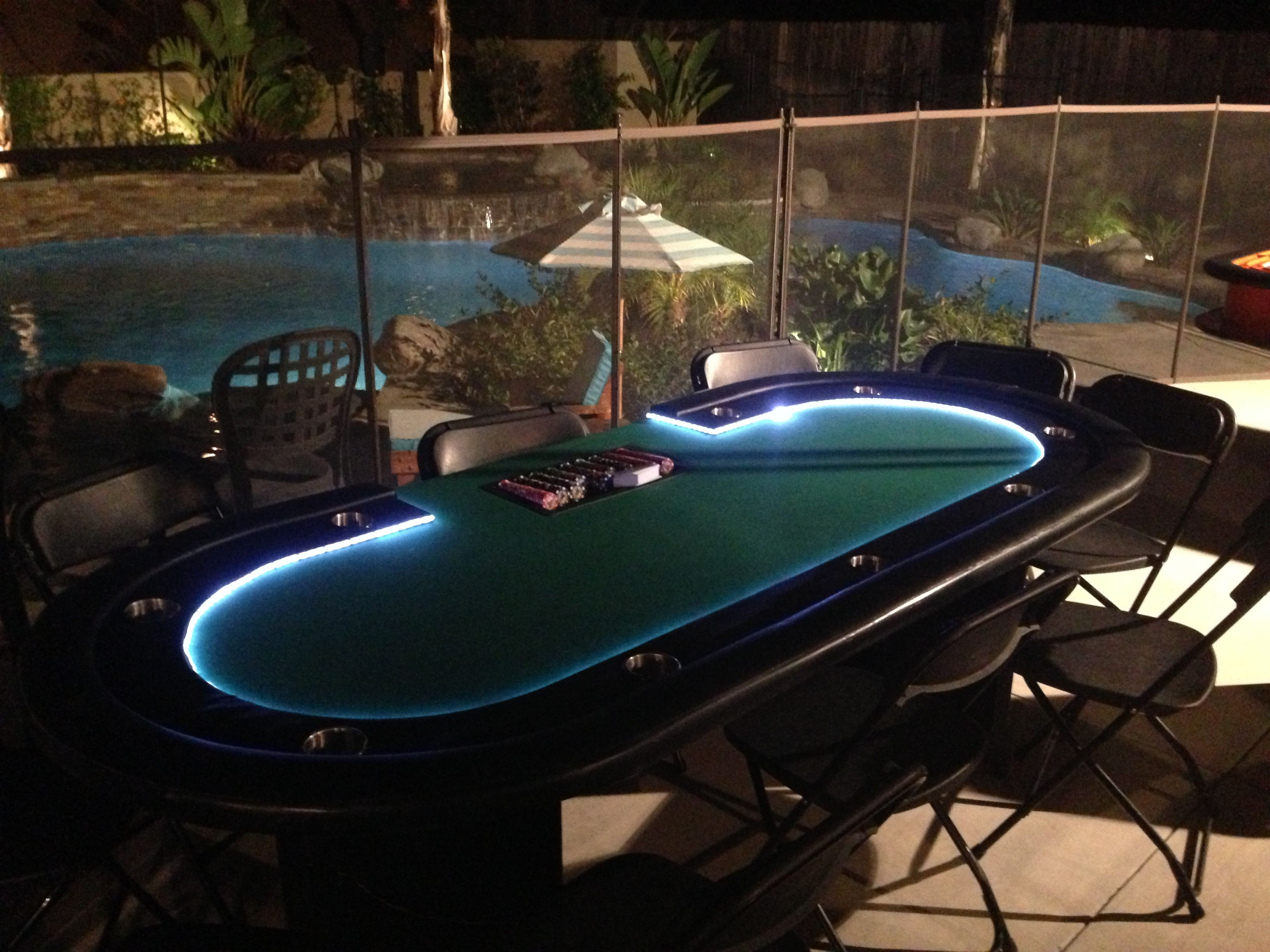 Deluxe LED Gaming Table Overlooking Beautiful Backyard And Pool Lights Light Up The Game