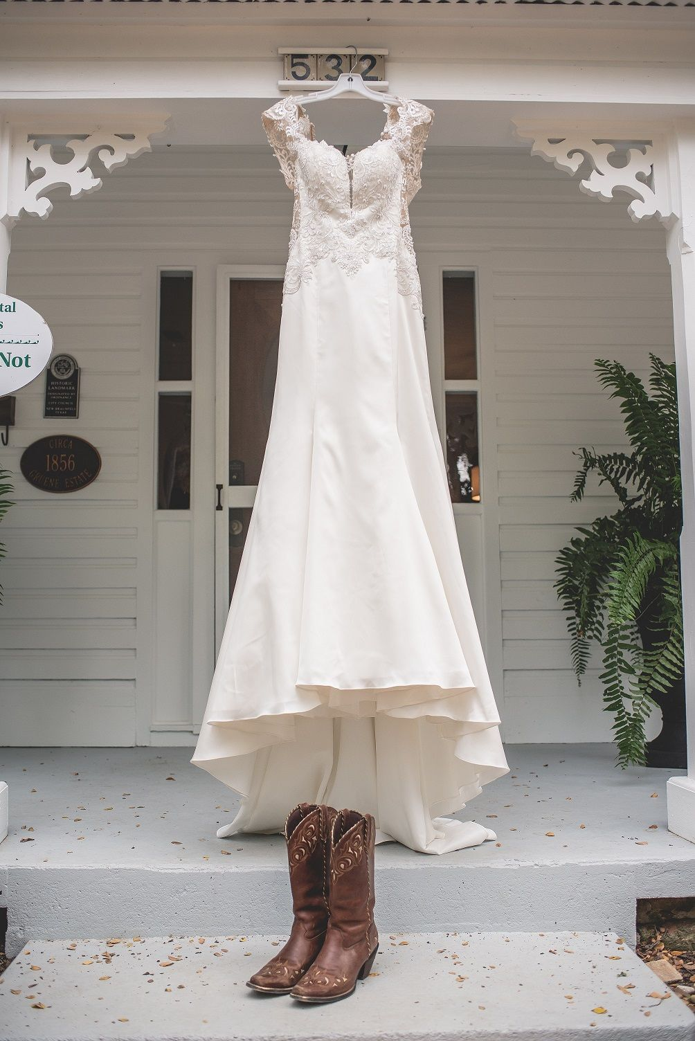 Andrea deane scoop neck line lace wedding gown at a rustic wedding