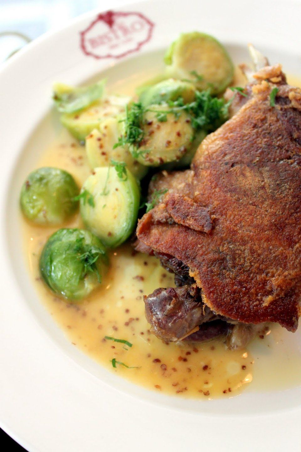 Duck confit and roasted brussels sprouts by chef hayden