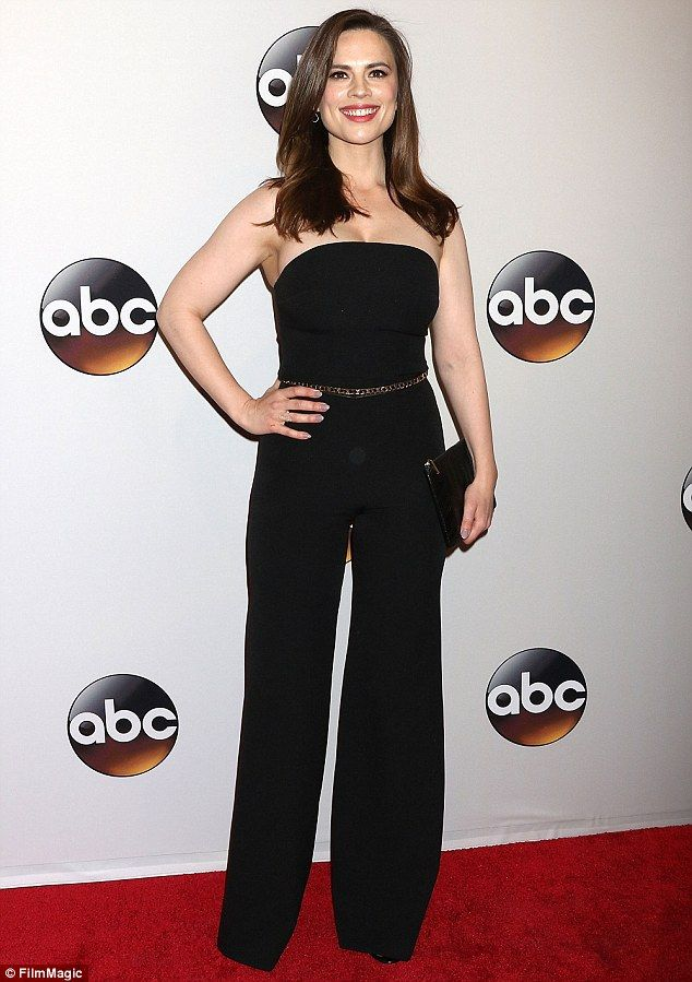 5e28f8439ab Natural beauty  Hayley Atwell wore a strapless jumpsuit featuring flared  legs with a dazzl.