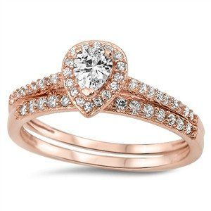 A Perfect 18K Rose Gold 15TCW Pear Cut Halo Russian Lab Diamond