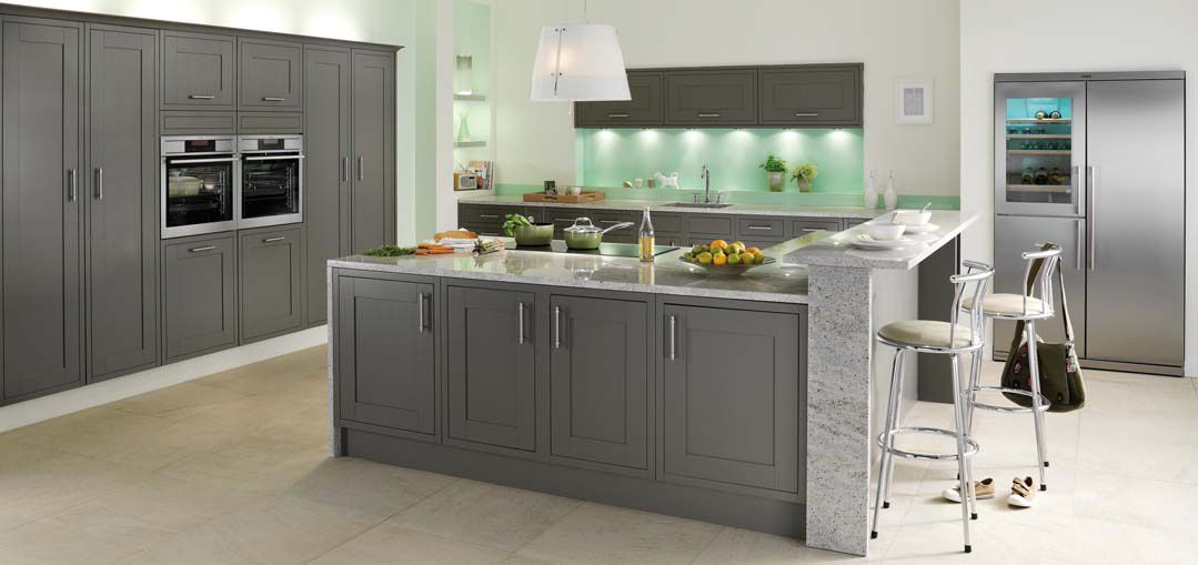 A big and spacious kitchen design done in gray stainless for Contemporary fitted kitchens