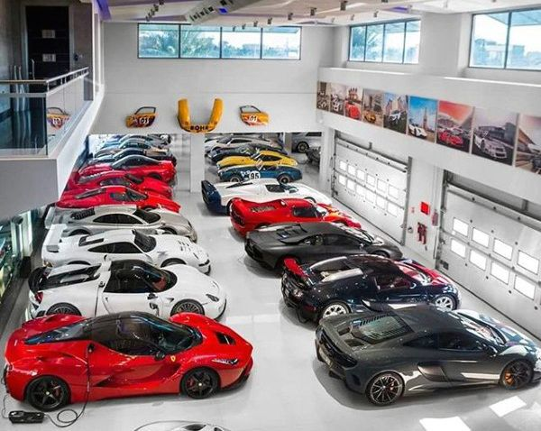 Huge car collection dream garage filled with exotics lit for Car collector garage plans