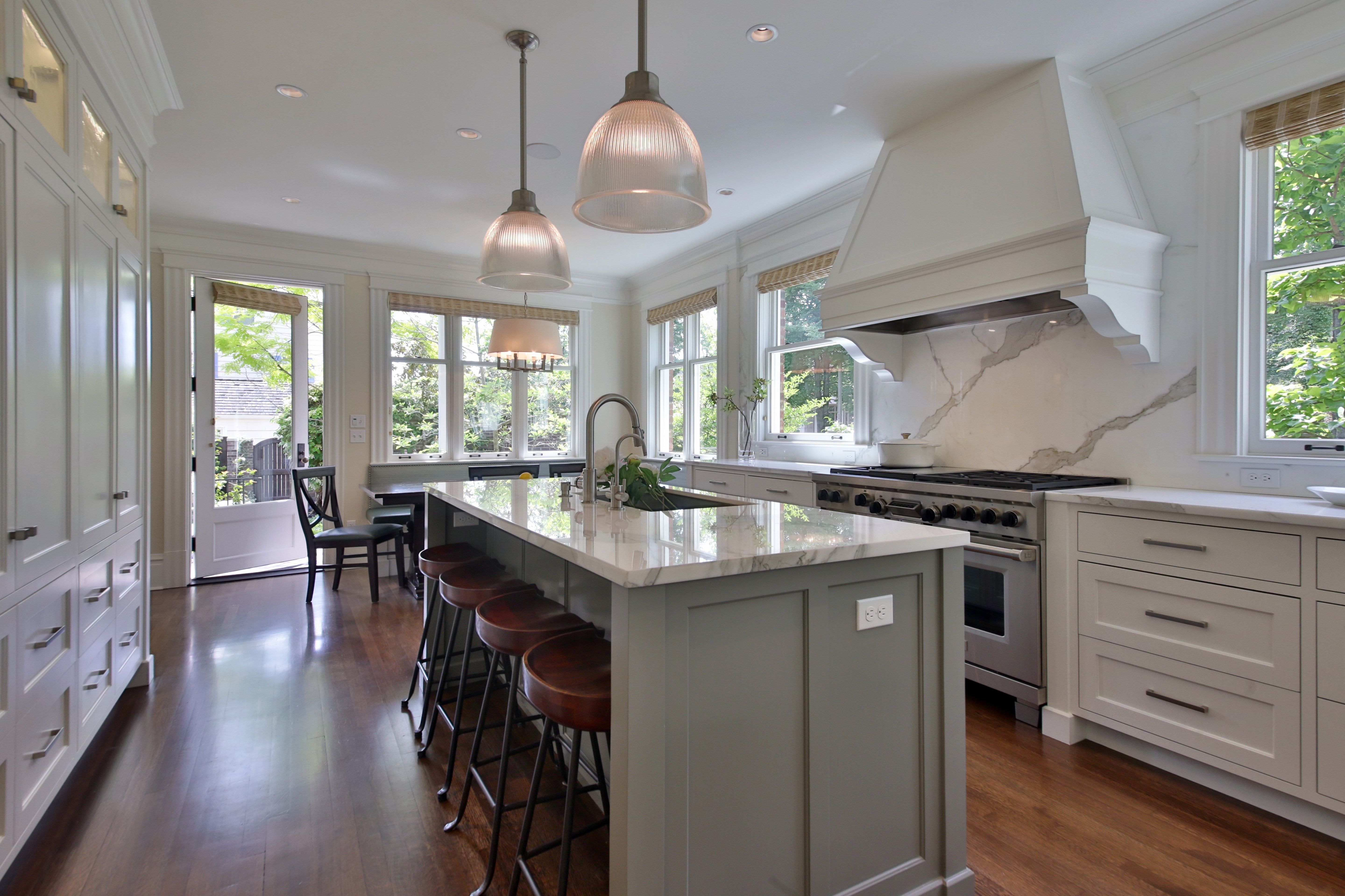 Seattle Kitchen with Grey Island White Cabinets & Hood Marble