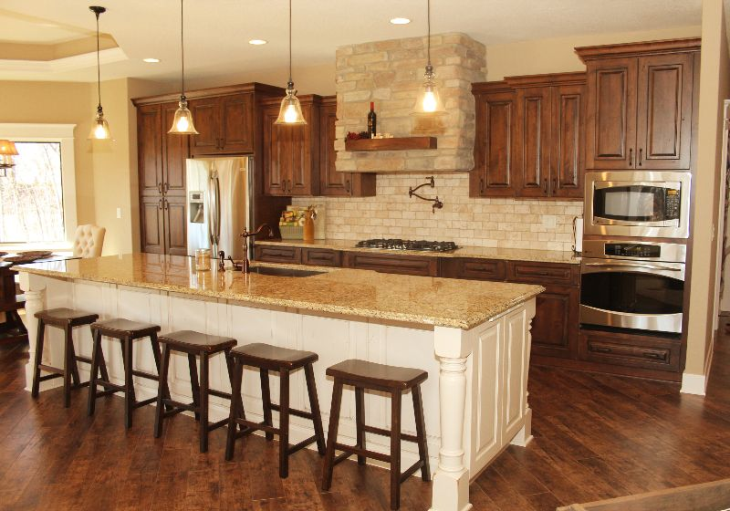 Love the white island and the stained cabinets. | Brown ...