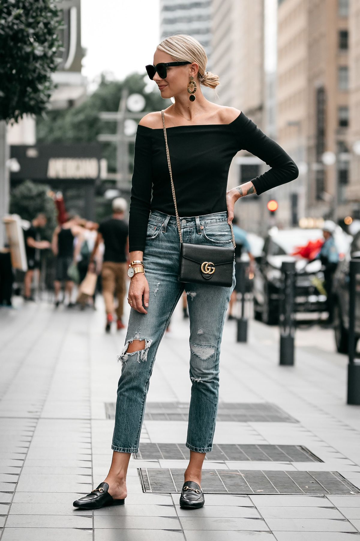 e0352b1791dc Blonde Woman Wearing Jcrew black off the shoulder top Levis Denim Ripped  Jeans Gucci Marmont Handbag