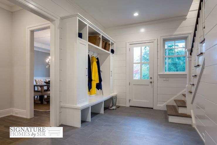 Foyer Tile Zone : Informal entryway features white glass pane front door