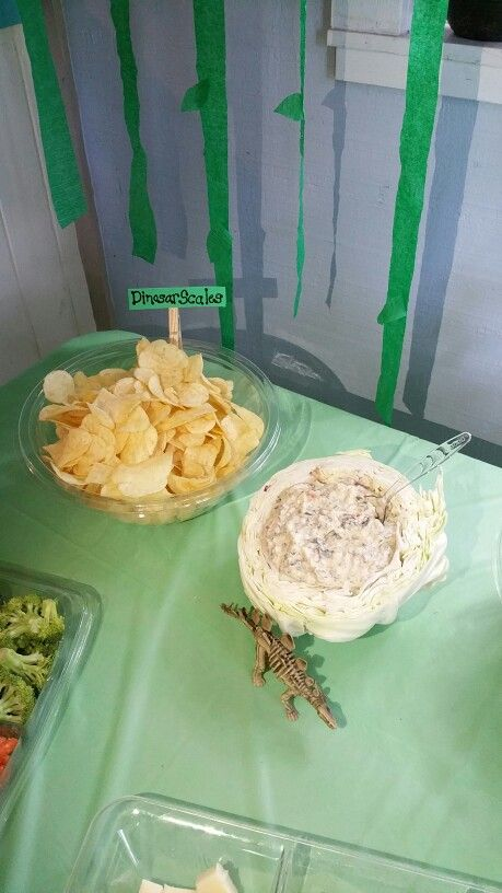 Lays chips for Dino Scales and cut cabbage in half and dig center out and add spinach dip.