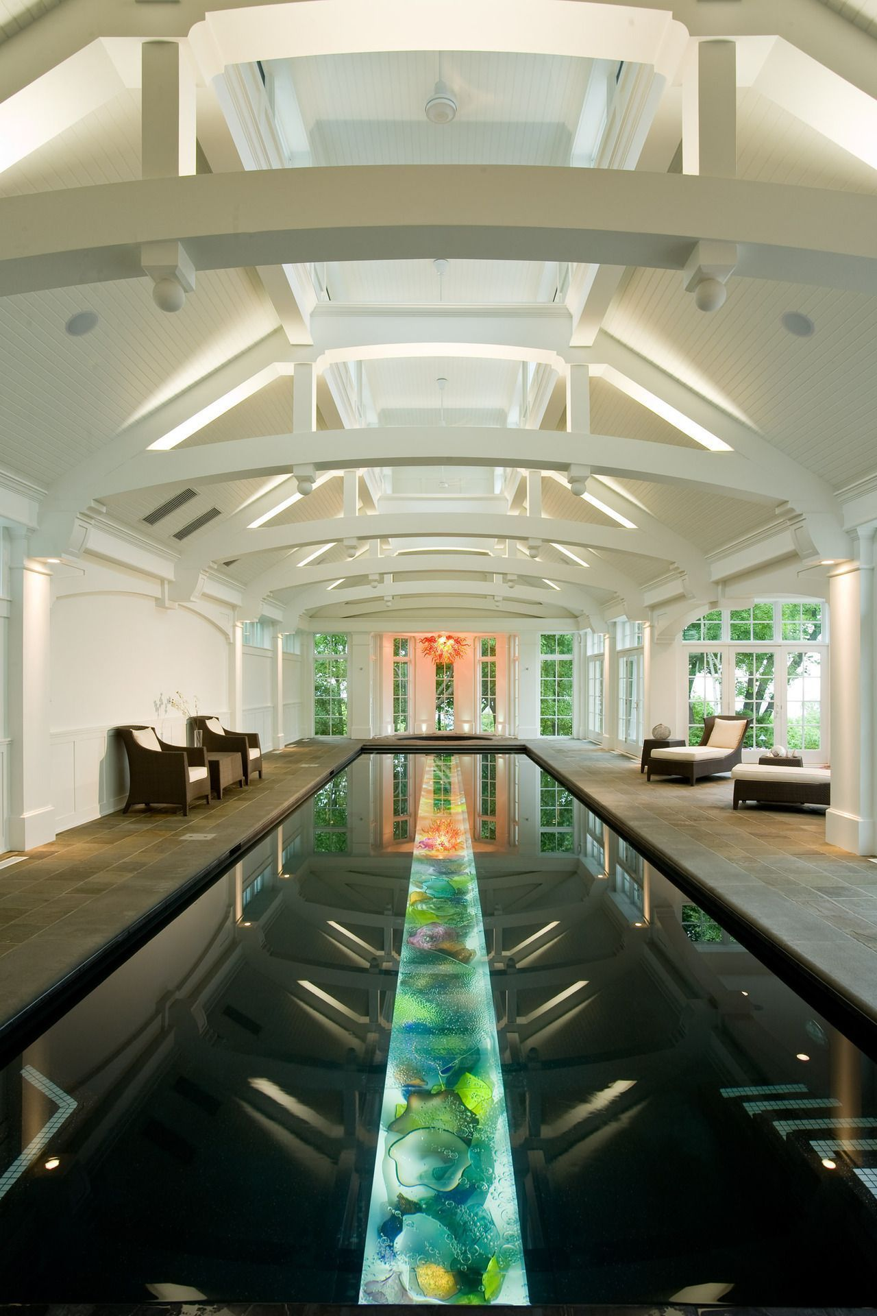 Indoor Pool Room Features A Vaulted Ceiling And A Lap