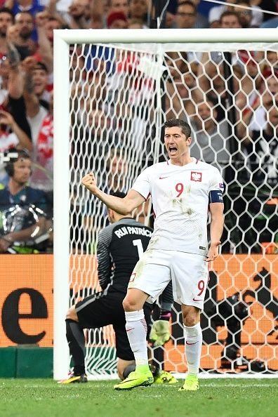 #EURO2016 Poland's forward Robert Lewandowski reacts after scoring in a penalty shootout during the Euro 2016 quarterfinal football match between Poland and...