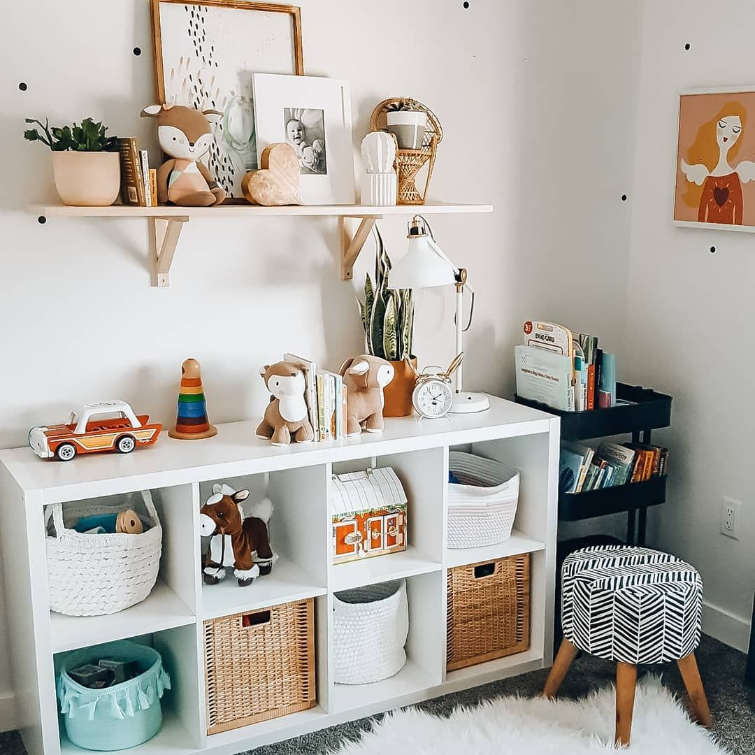 Cute Ikea Kallax shelf in the nursery and pretty