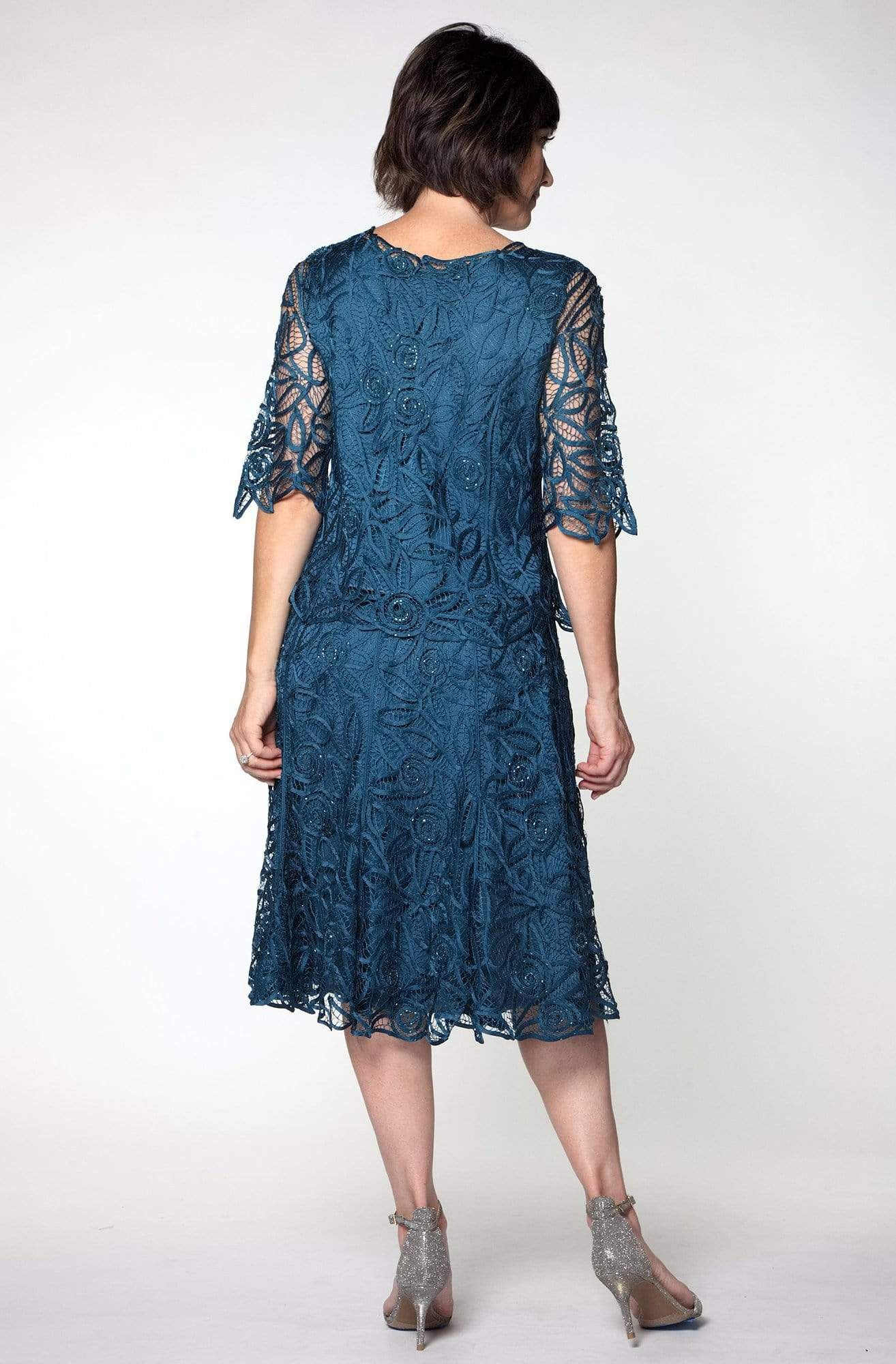 This lovely two pieces Soulmates short sleeve tunic with knee length skirt with hand-embroidered and crocheted and shimmering beads gives younger and chic looks one of Soulmates best spring/summer collection dress. 100% Silk Hand-made Fully-lined Dry Clean Imported