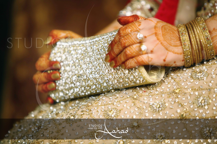 Aahad studios photography | Beautiful hands with clutches | Pinterest