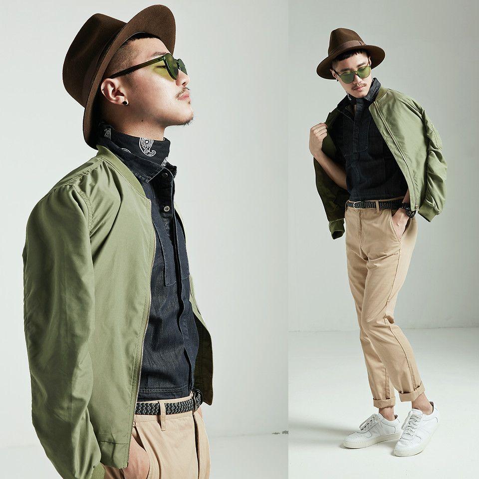 Cuffed khakis, dark button down, varsity jacket, sneakers