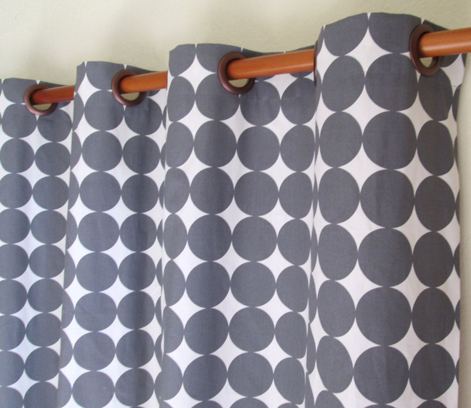 Pair of wide dwell studio dotscape fabric rod by liveplush