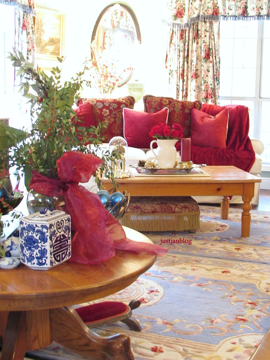Welcome to Christmas here in the family/living room in our home. Lots of red is still living here with the new white sofas. My daughter got one of the red sofas that I had, so I kept the pillows …