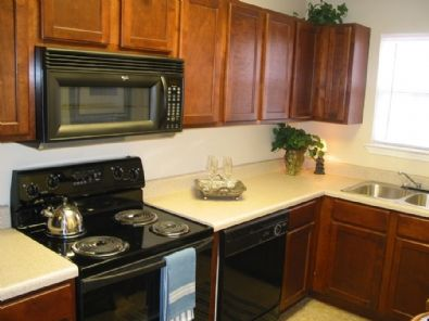 Beautiful Cherry wood cabinets and new appliances in this ...