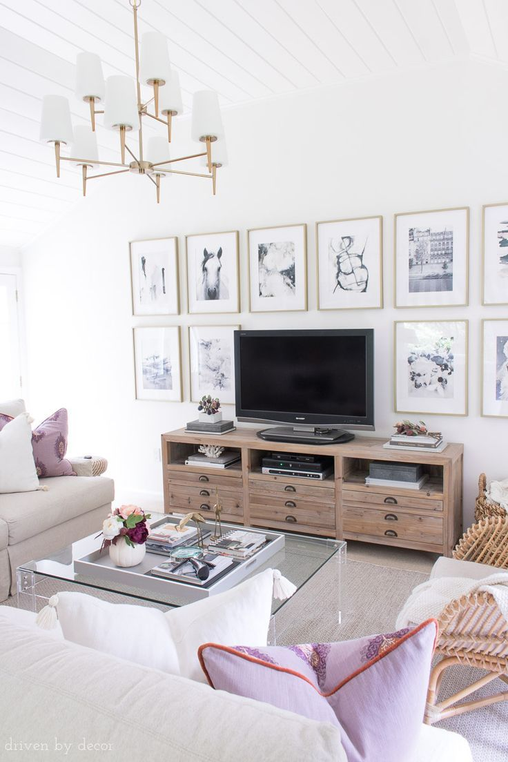 Loving This Family Room Decorated For Fall With Plum Home Accessories And That Art Wall Around The Tv Living Room Tv Wall Decor Around Tv Living Room Decor
