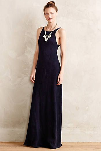 love the elegant high neck, and it's got a plunging bare back which is beautiful