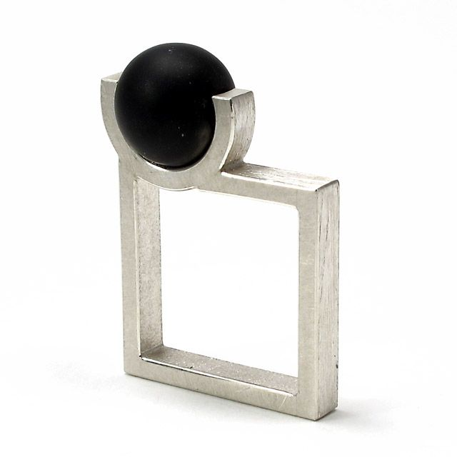 Geoffrey D. Giles square ring in silver and black onyx.