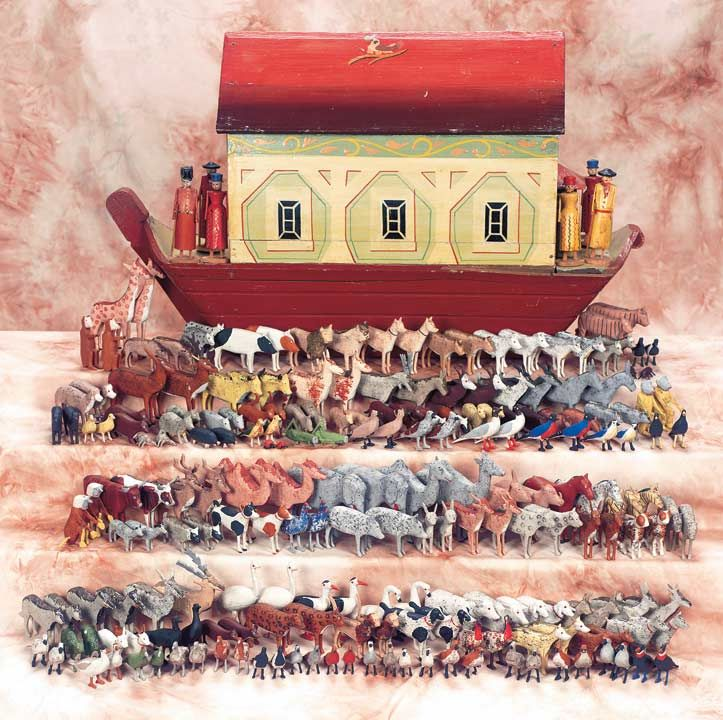 """An Extraordinary Mid-19th Century Noah's Ark with 250 Figures,and Original Document 24"""" (61 cm.) l. The wooden Noah's Ark is fancifully-painted,having shaded red roof decorated with a painted bird on a branch,and painted sides to suggest shuttered windows,architectural supports and decorative borders. Included with the Ark are six wooden people with painted costumes (including Noah wearing an unusual Admiral's cap and uniform); 72 pairs of animals,44 pairs of birds and owls,and 5 pairs of…"""