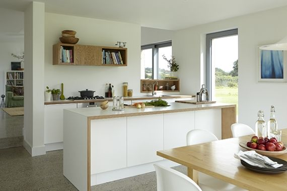 The Applåd kitchen and birch table are from Ikea The oak shelf unit