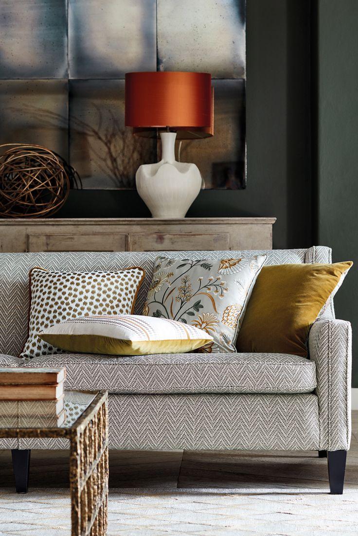 An Elegant Grey Sofa In Tamarind Natural Slate Cushions Ka