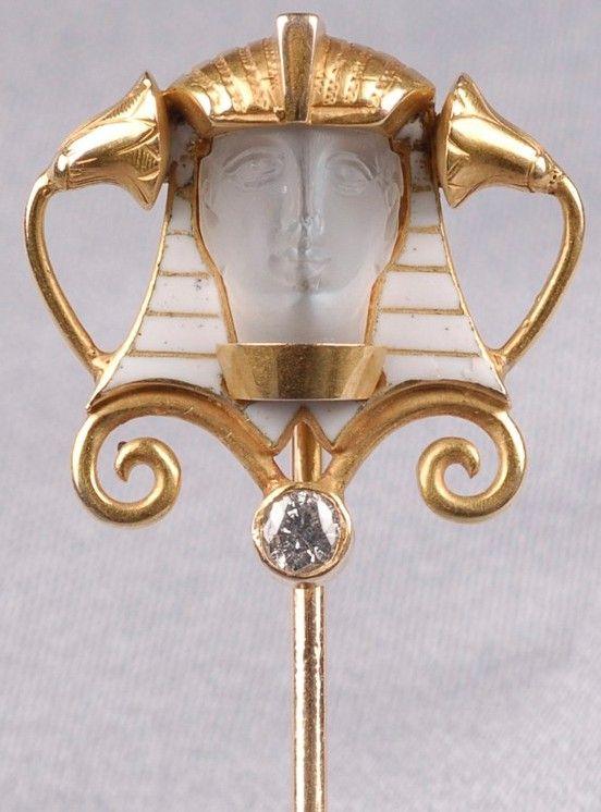Stickpin; Egyptian Revival, 14K Gold Mount, Carved Moonstone Pharaoh in Enamel Headdress, Diamond Accent.