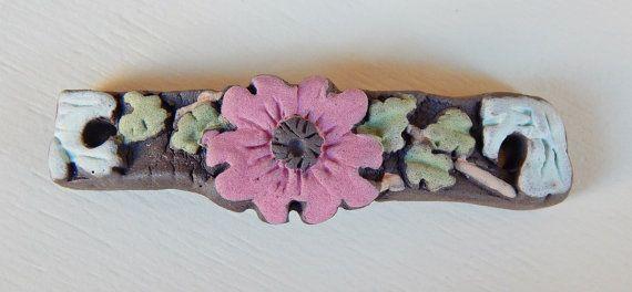 Handmade black ceramic bracelet bar  flowers . por Majoyoal en Etsy
