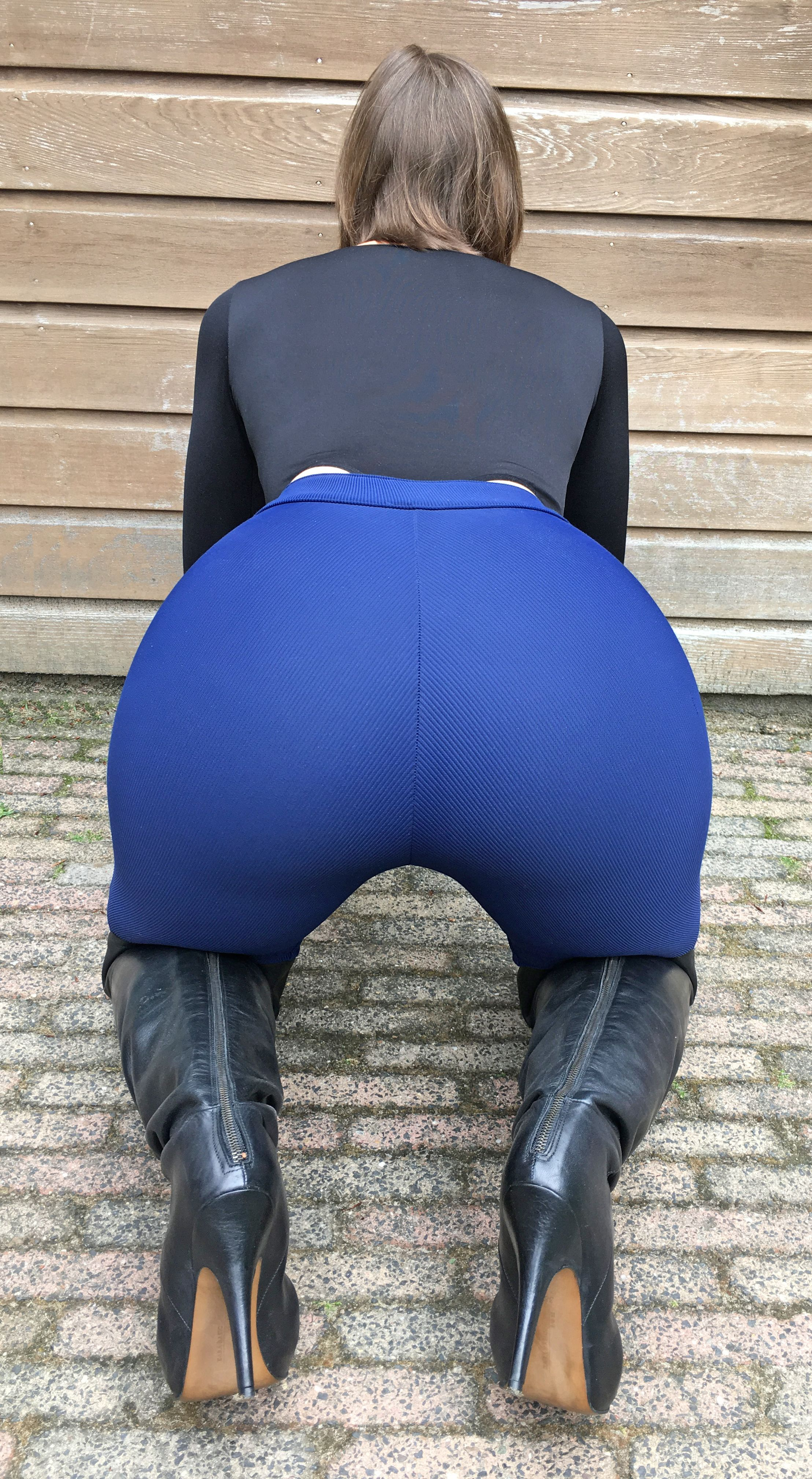 Stephanie Wolf - wearing my blue riding pants with a butt plug underneath