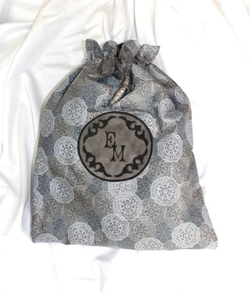 Pack up your stuff in our Gray Medallion scroll framed monogrammed draw string travel bags! Monogrammed in a black font. Great tor shoes, lingerie, or toiletries. Protect your pretty shoes while trave
