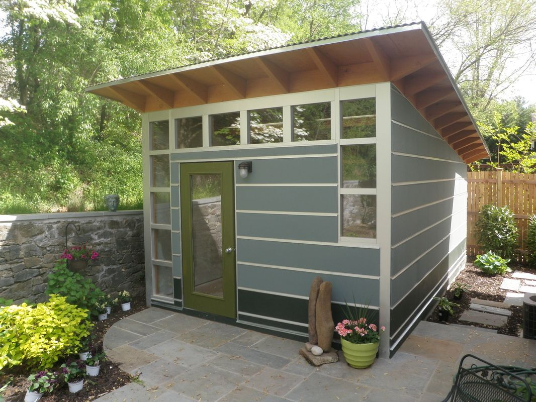 Small shed design with glass door and windows in natural for Modular studio shed
