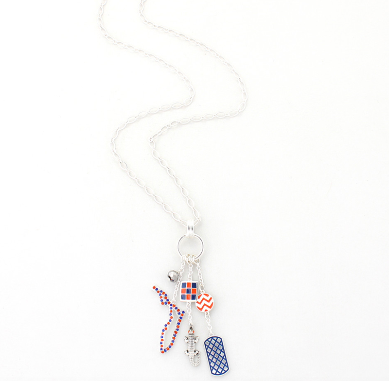 This necklace features a cluster of charms with orange and white enamel charms, an orange and blue crystal charm featuring the outline of the state of Florida and a silver plated gator charm.