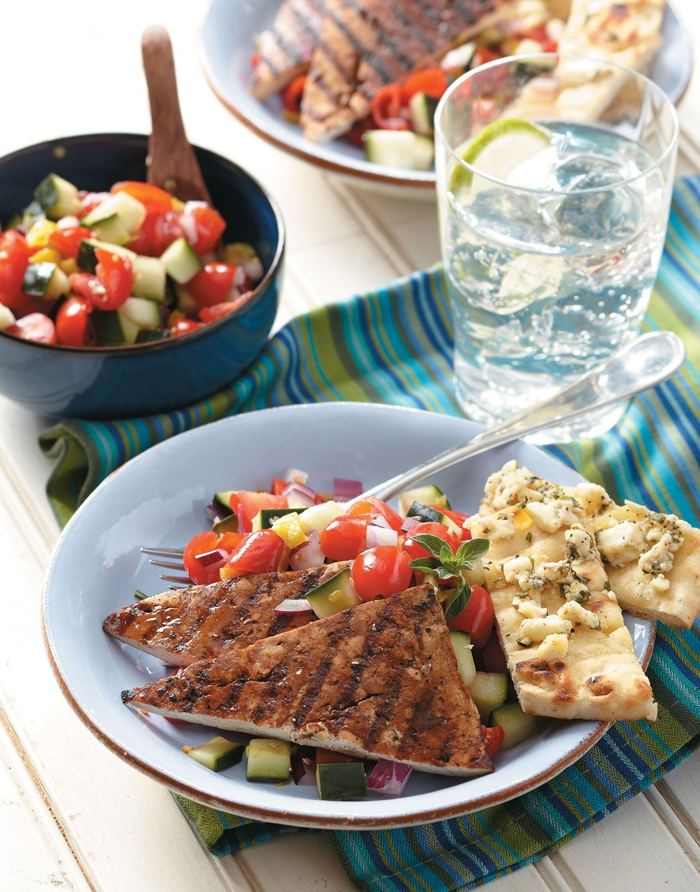 Greek Tofu Steaks Greek Tofu Steaks | Marinated and grilled to perfection, tofu is the perfect protein to pair with a summery Greek salad and cheesy flatbread.