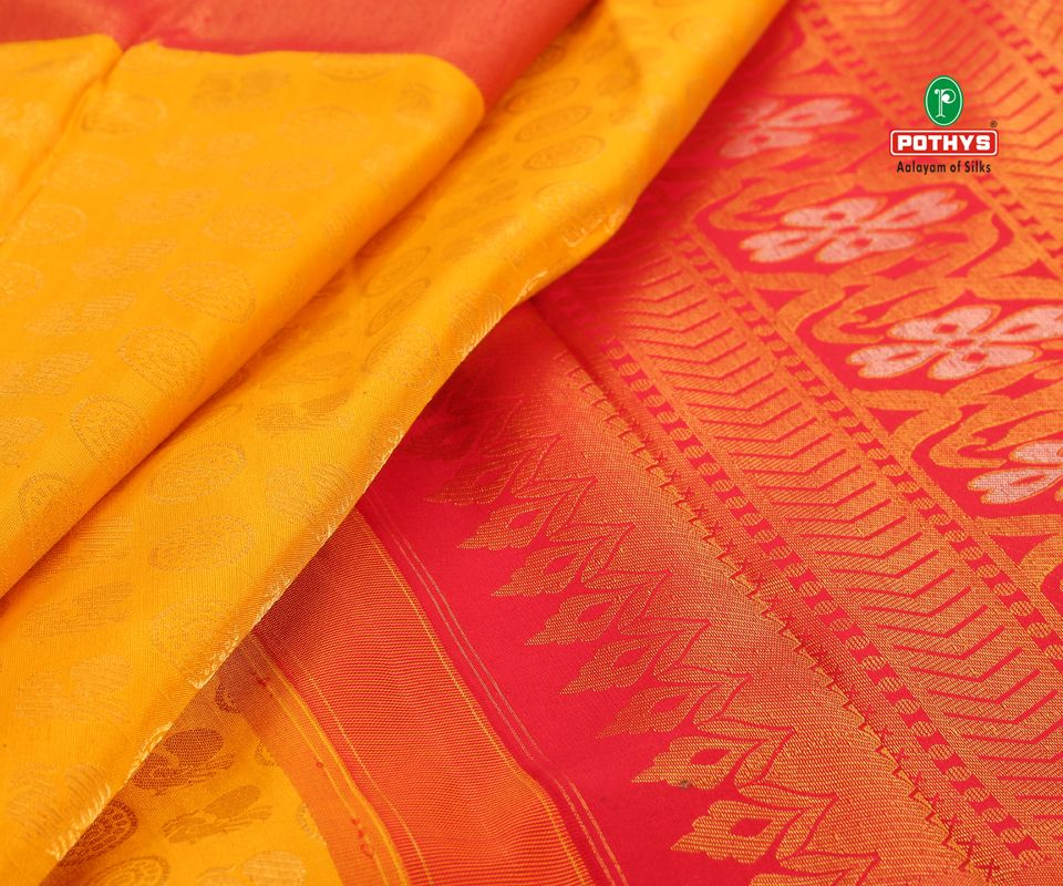 1be746f191 This beautiful yellow and pink silk saree with delicate designs in it makes  it look ravishing when worn on any occasion. Shop this now.