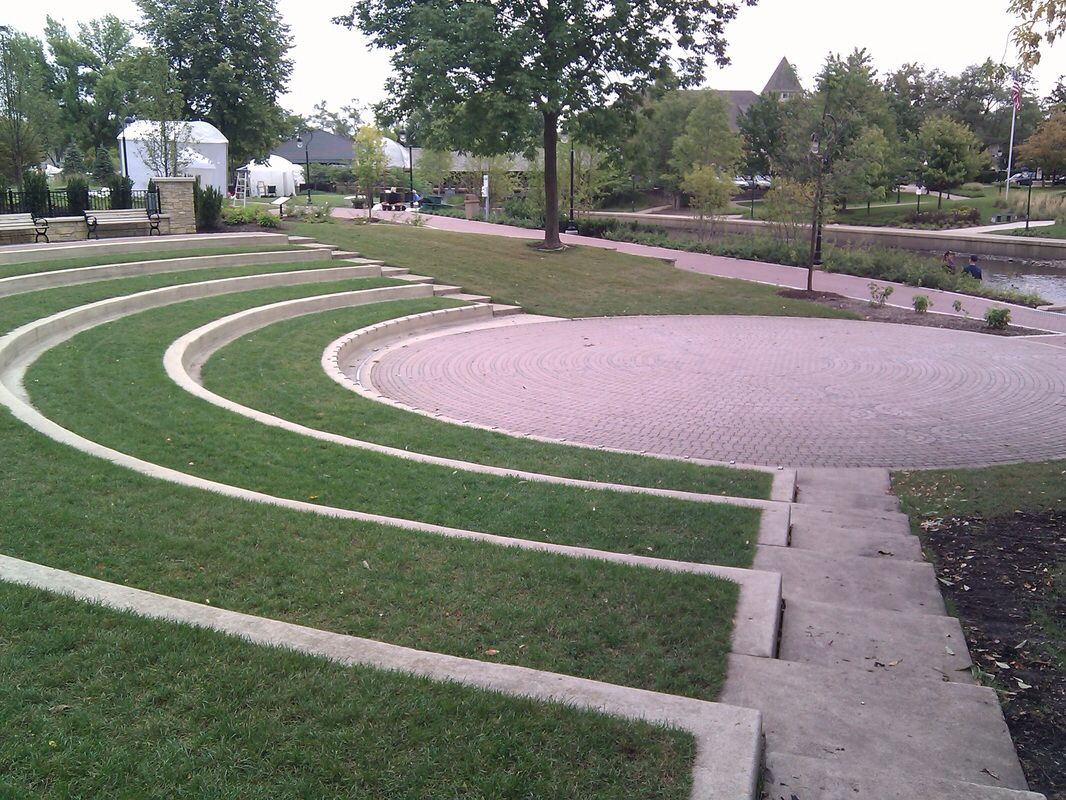 Outdoor amphitheater with grass seating; would be better ...