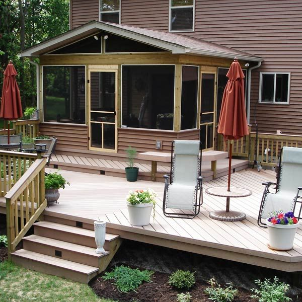 With Rustic Wood Accents This Double Door Screened Room Exits Onto A Maintenance Free Double Level Deck The Top Are Porch Design House With Porch Deck Design