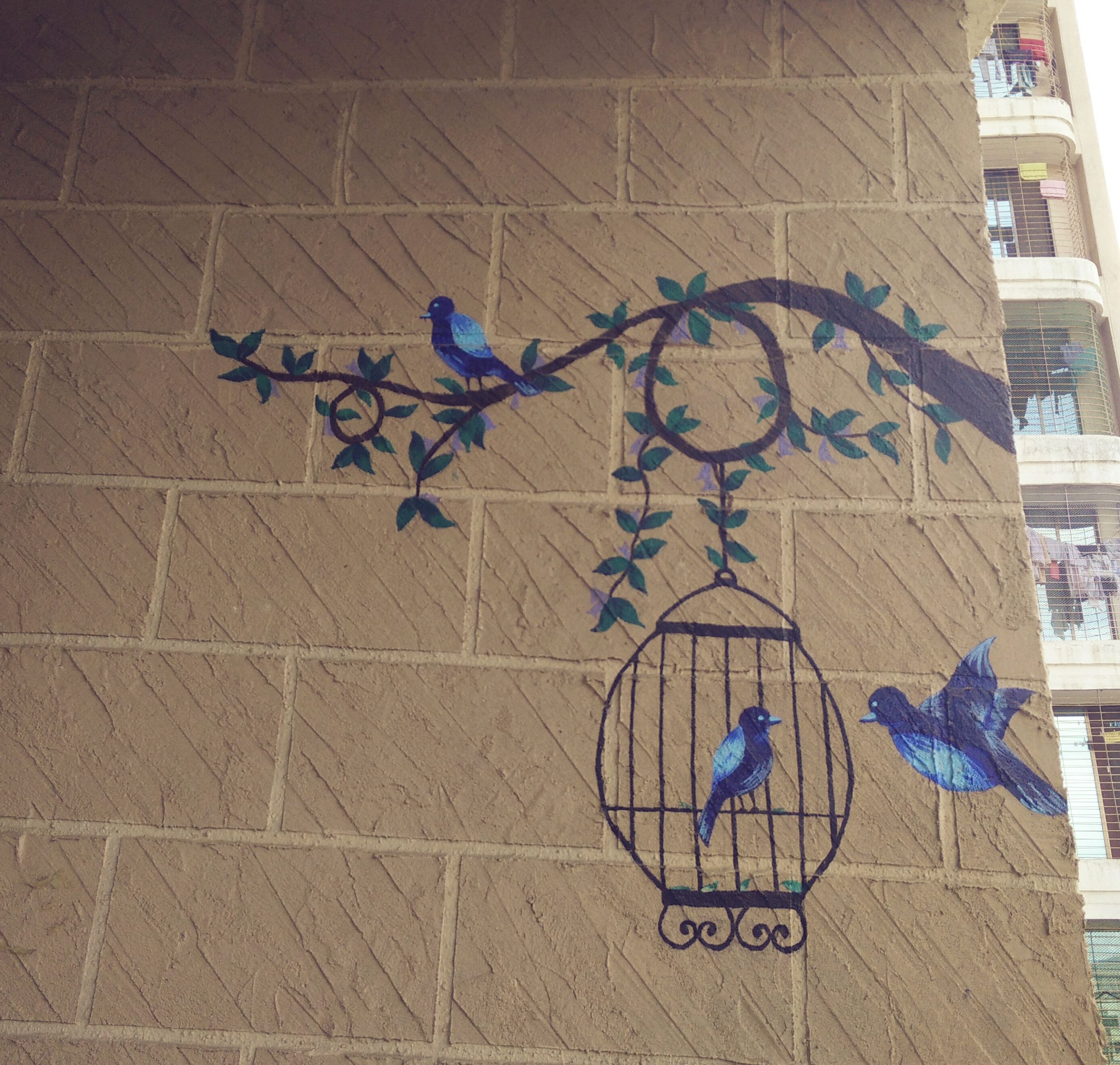 c5d40e915d7a A weekend spent in the balcony with my paintbox.  wallpainting  decor  birds   leaves  flowers  interiors  painting  walls  blue  cage  greens  brickwall