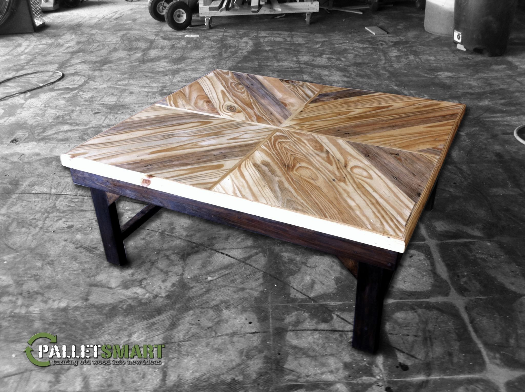 Repurposed pallet wood coffee table with a double chevron design