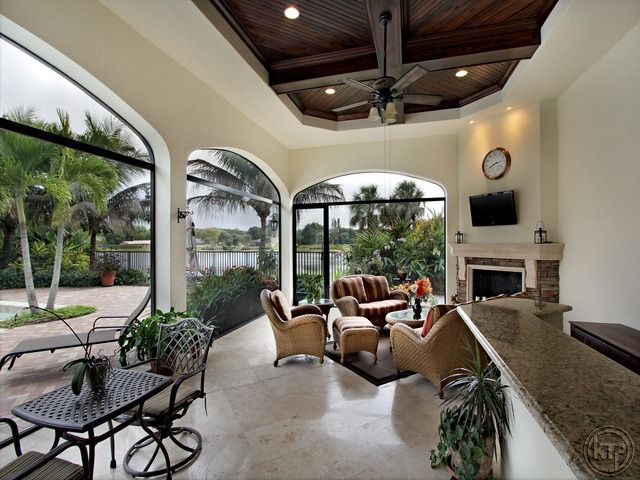 screened lanai with wood ceiling fireplace and tv built in outdoor kitchen il regalo in on outdoor kitchen tv id=13779